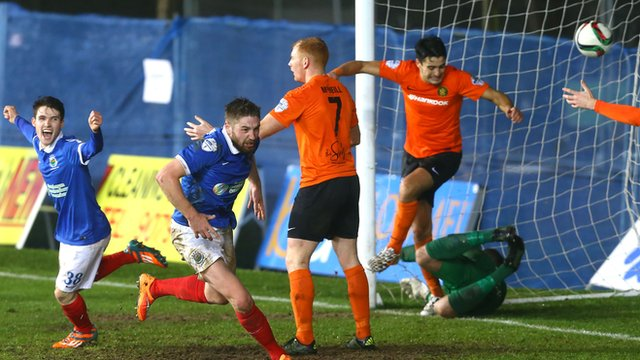 Mark Stafford heads in Linfield's second goal against Carrick Rangers
