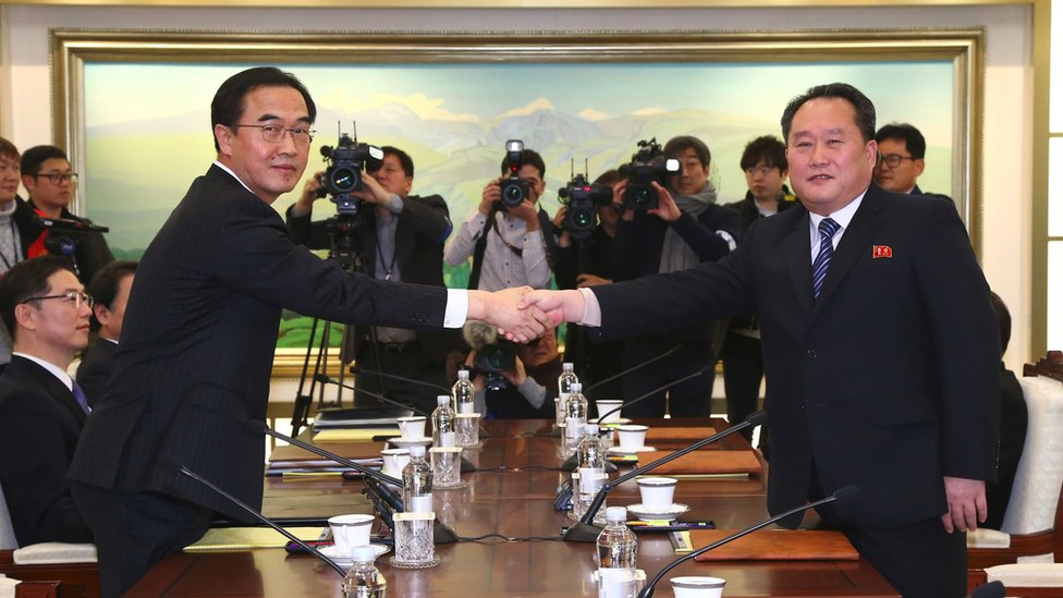 South Korea Unification Minister Cho Myung-Gyun (L) shakes hands with North Korean chief delegate Ri Son-Gwon (R) during their meeting at the border truce village of Panmunjom in the Demilitarized Zone (DMZ) dividing the two Koreas on January 9, 2018