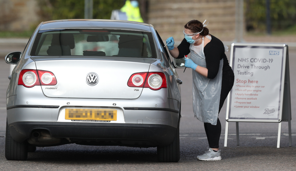 Medical staff testing people at a drive-through centre