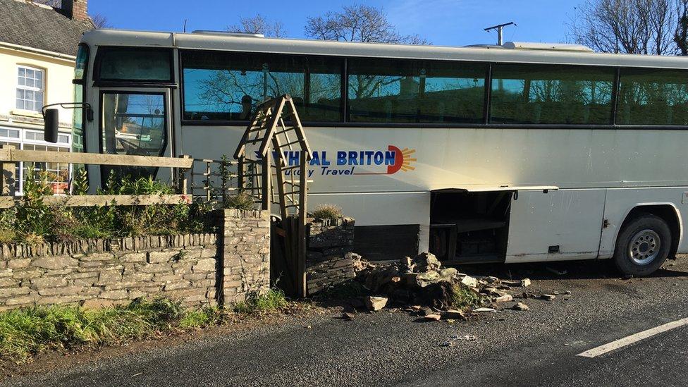 Coach crashes into wall