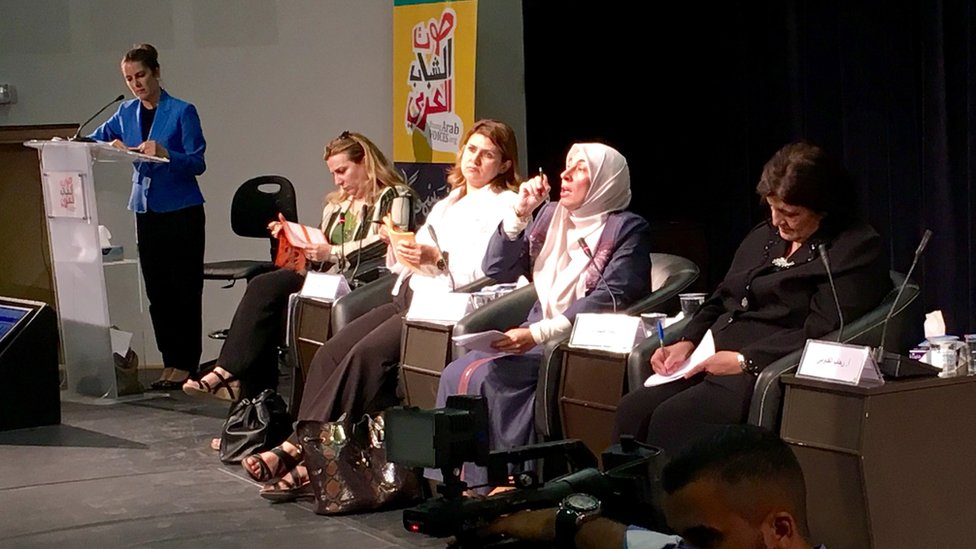 Dima Tahboub (seated, talking)