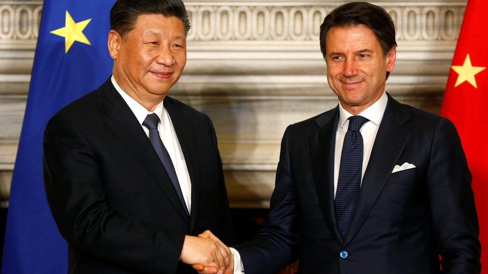 Italian Prime Minister Giuseppe Conte and Chinese President Xi Jinping shake hands after signing trade agreements at Villa Madama in Rome,