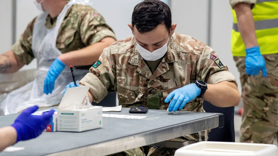FILE PHOTO: Soldiers work at The Exhibition Centre, which has been set up as a testing centre as part of the mass coronavirus disease