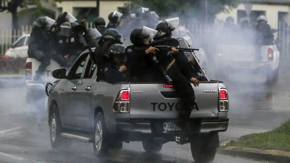 Riot police clash with protesting engineering students in Managua on May 28, 2018