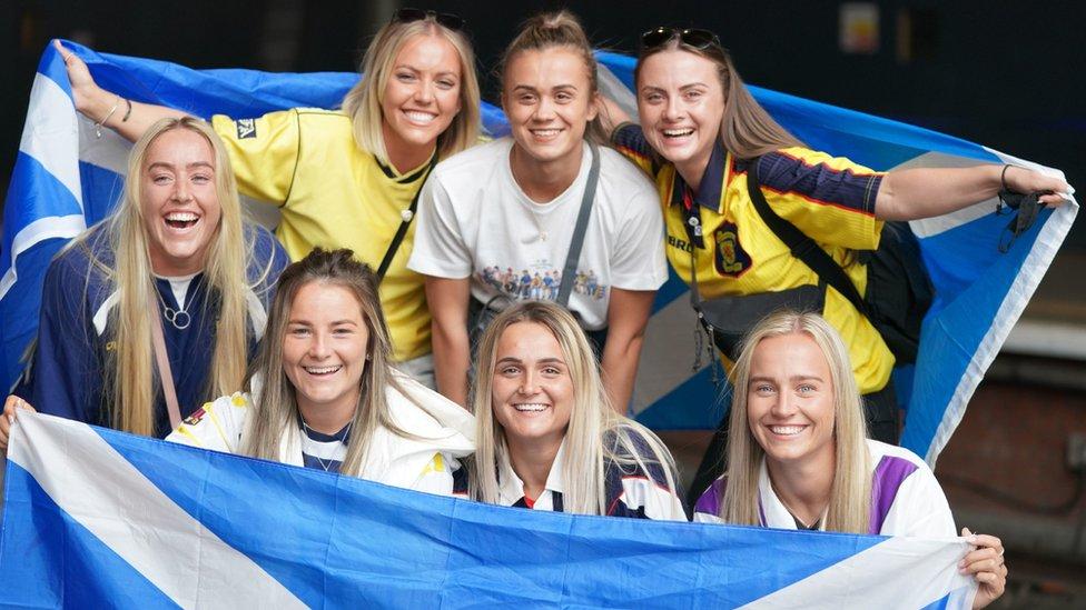 fans at Edinburgh Waverley station on Friday