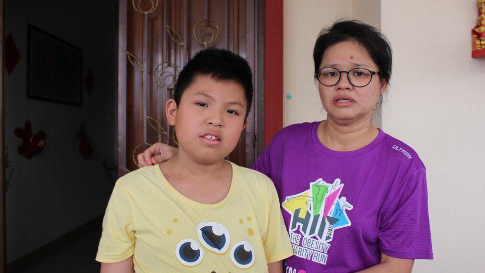 Belle Tan y su hijo de once años