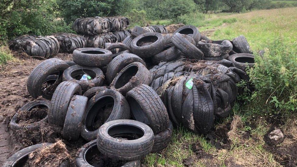 Tyres dumped in a field