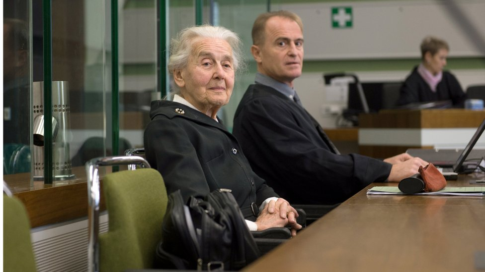 Ursula Haverbeck, accused of denying the holocaust, sits with her lawyer Wolfram Nahrath in a courtroom in Berlin.