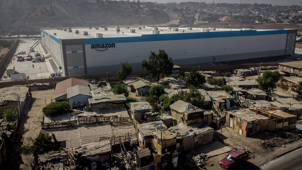 Shacks are seen at an informal settlement next the new Amazon fulfilment centre, which is under construction at the RMSG Alamar Industrial Park, in Tijuana, Mexico September 7, 2021.