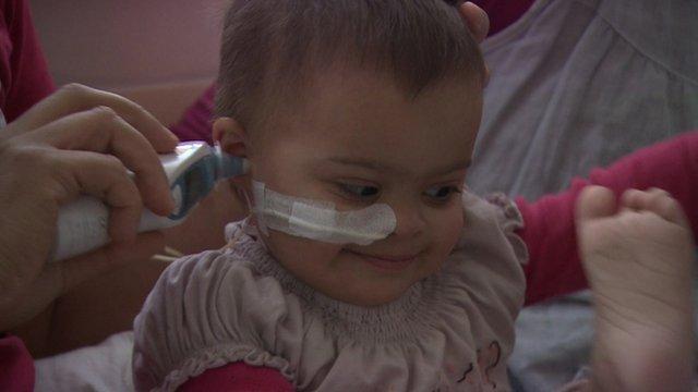 Baby having ear checked in hospital