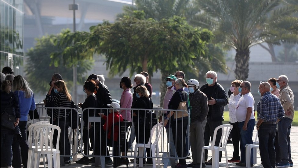 People waiting in line to get the first dose of coronavirus vaccine, in the Heichal Shlomo Sports Arena that turned into a massive vaccination center in Tel Aviv, Israel, 22 December 2020