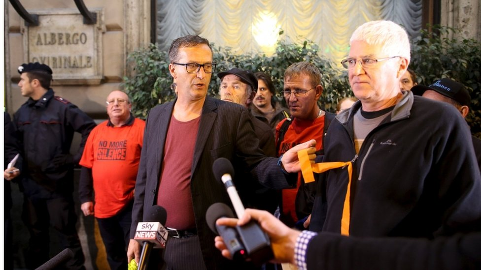 Australian child abuse victim David Ridsdale (right) and other observers arrive at the Quirinale hotel in Rome to hear Cardinal Pell give evidence, 28 Feb 2016
