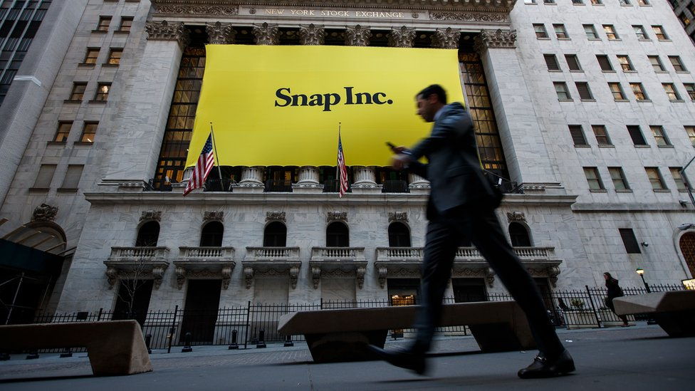 Signage for Snap Inc., parent company of Snapchat, adorns the front of the New York Stock Exchange (NYSE), March 2, 2017 in New York City.