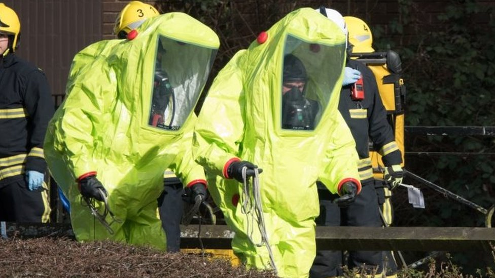 Officers in masks and jumpsuits after the nerve agent attack in Salisbury