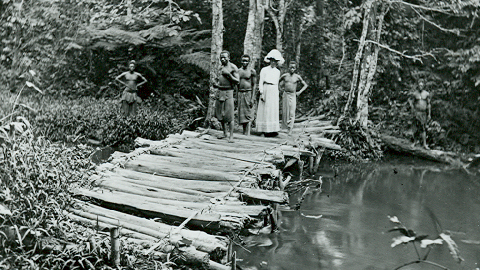 English missionary and photographer Alice Seeley Harris crossing a bridge in the Belgian Congo, c1900