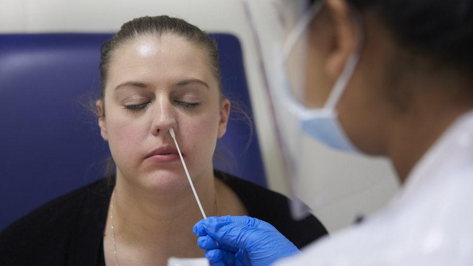 Boots to offer 12-minute turnaround on Covid nasal swab test - BBC News