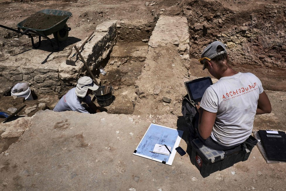 An archaeologist works at the dig near Vienne, south-eastern France, 31 July