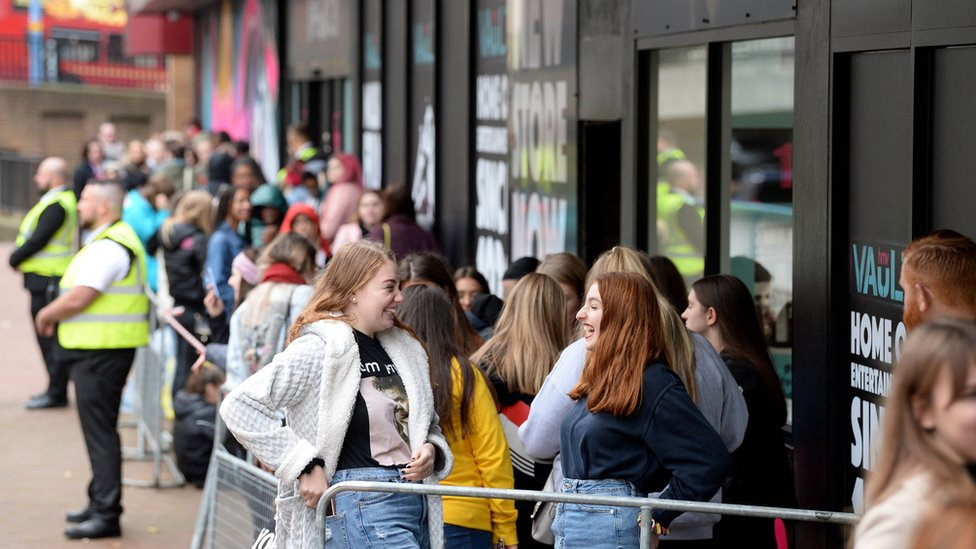 Crowds queue outside to see singer Liam Payne perform at the launch event of the HMV Vault in Birmingham