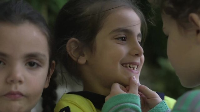 Three children who have made the journey from Turkey to Lesbos
