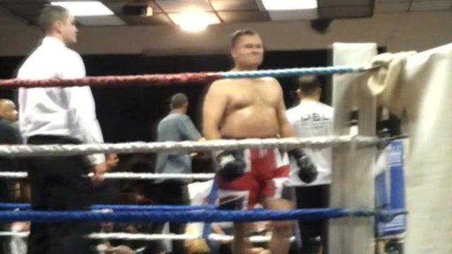 Lawrance walks around the ring
