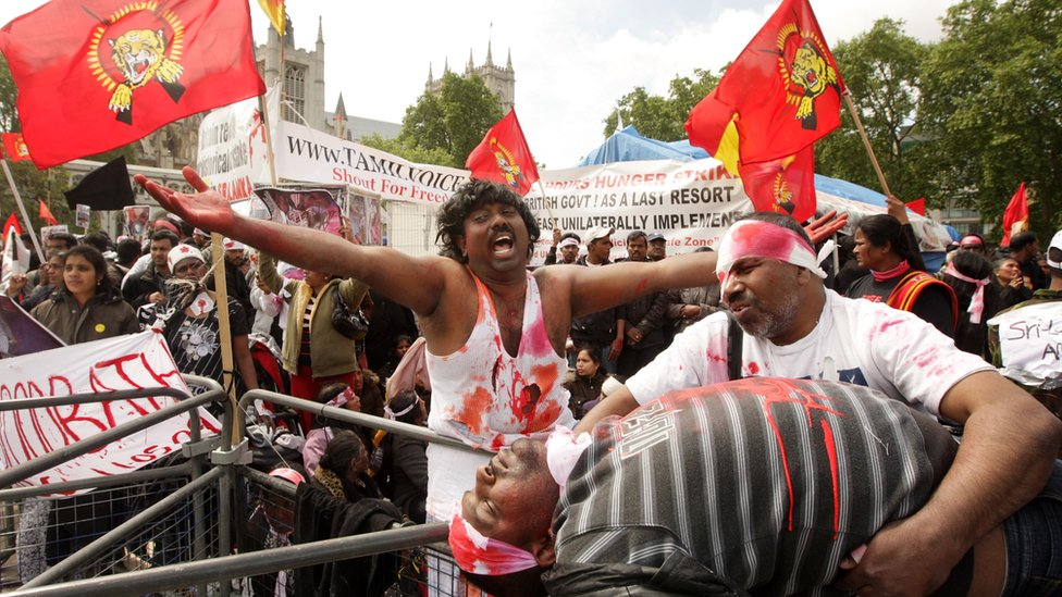 Protesters campaigning against the Sri Lankan government's offensive against the Tamil Tigers stage a mock battlefield scenario in Parliament Square on May 18, 2009 in London, England