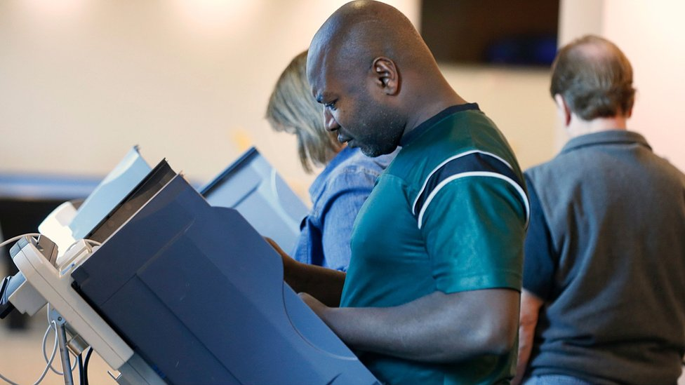 A voter casts his ballot in Utah