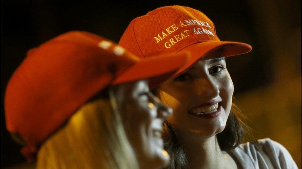 Women wearing MAGA hats