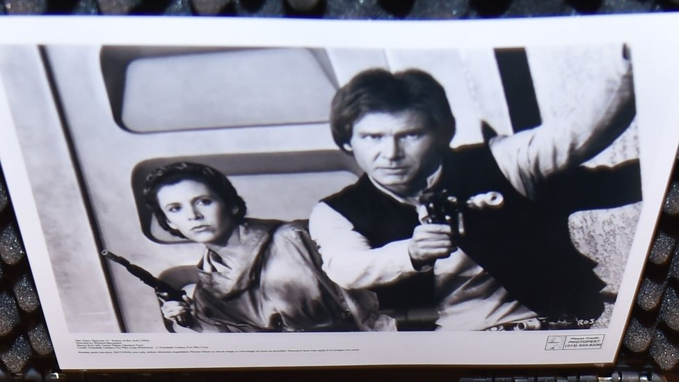 Han Solo brandishing the blaster