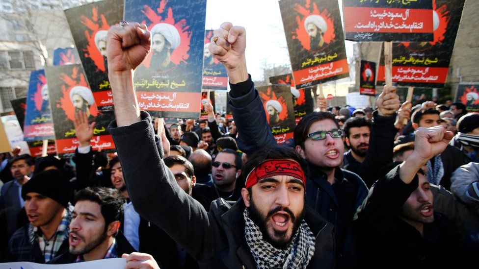 Iranian protesters hold posters of executed Shia cleric Nimr al-Nimr outside Saudi embassy in Tehran, 3 Jan 16