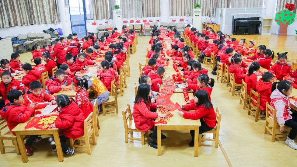 Children at a Jiangsu Province school before the Chinese New Year break