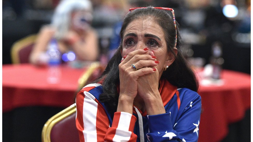 A voter in Las Vegas, Nevada, watches on anxiously for the latest count