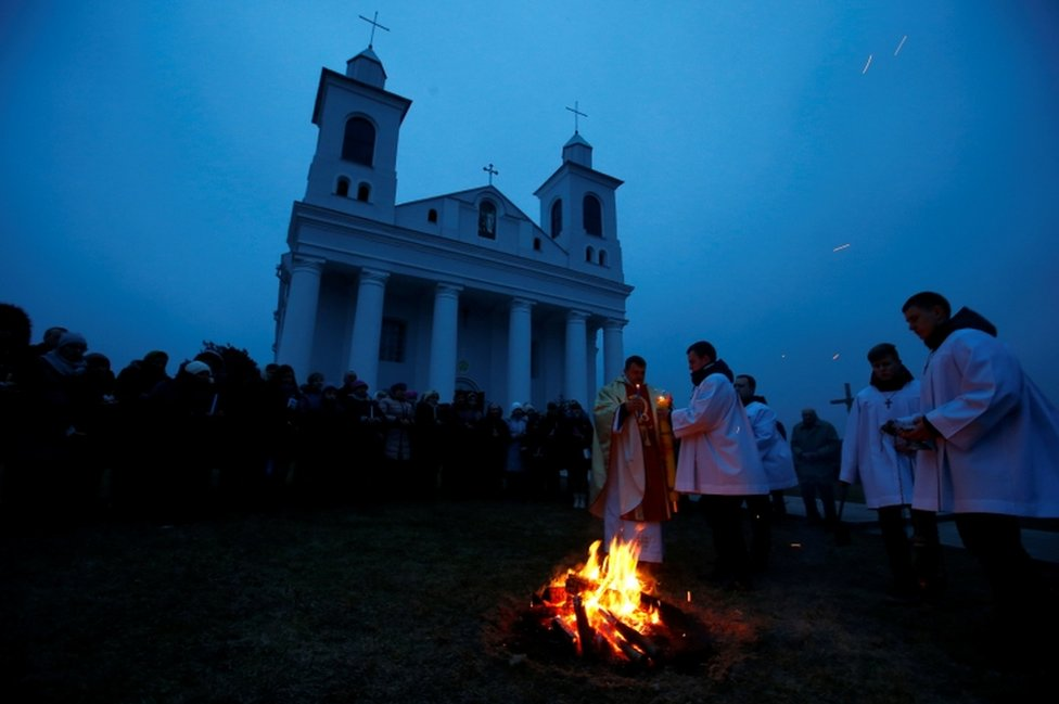 A Catholic priest conducts a service on Easter Eve in the village of Ragotna, Belarus March 31, 2018.