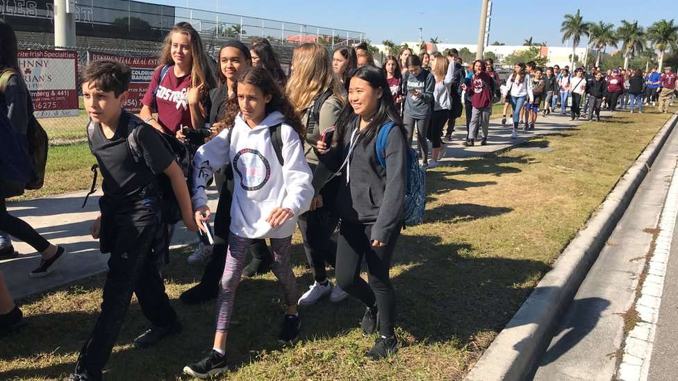 Students walkout at Marjory Stoneman Douglas High School during National School Walkout to protest gun violence in Parkland, Florida, U.S., March 14, 2018