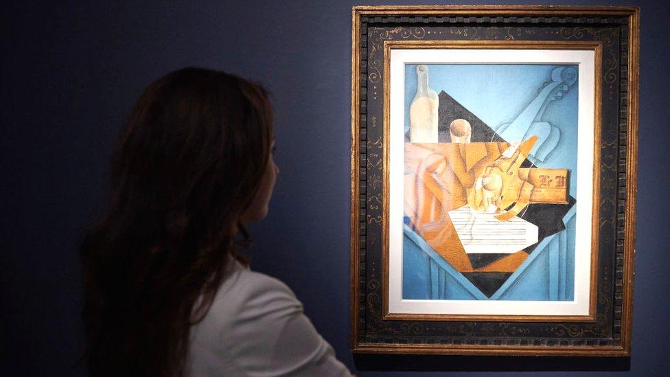 Woman looking at Juan Gris painting