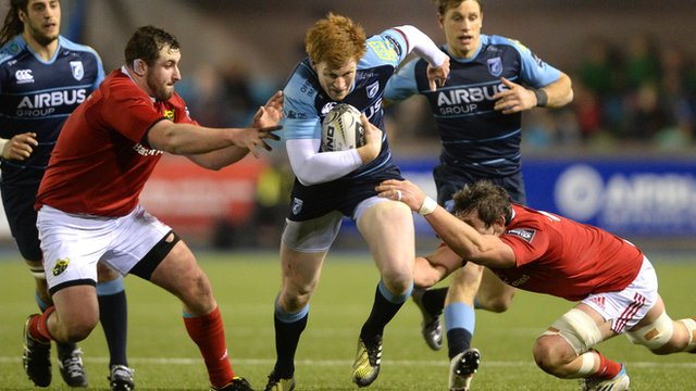 Rhys Patchell of Cardiff Blues is tackled by James Cronin and Dave O'Callaghan of Munster