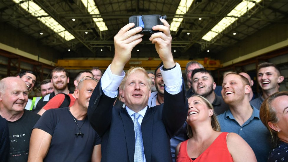 Boris Johnson using a mobile phone to take a selfie
