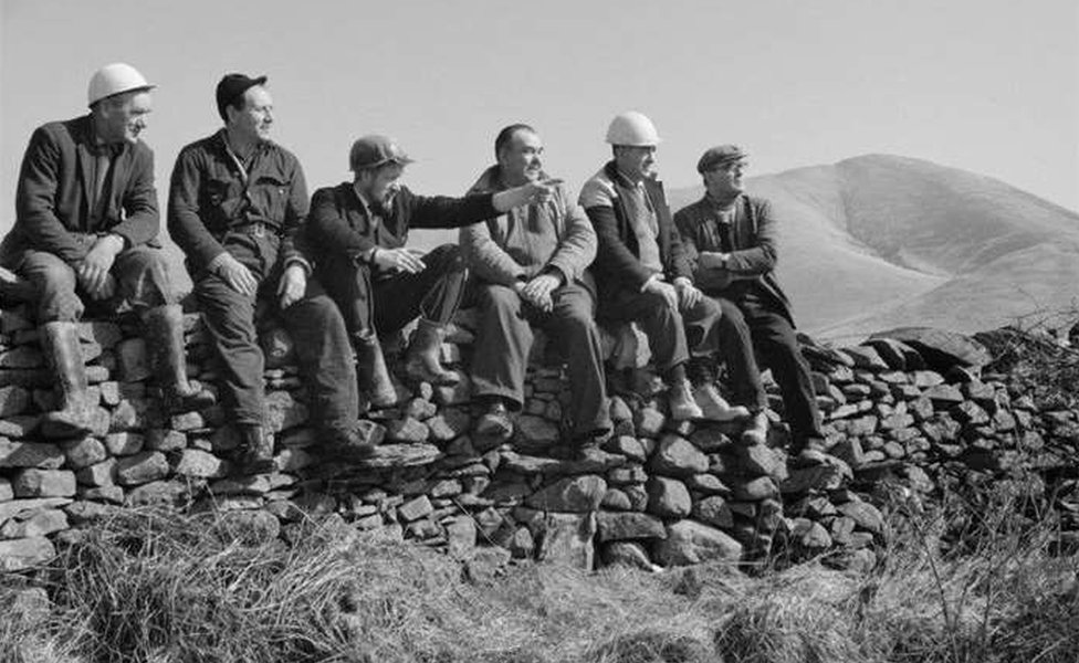 Workmen sitting on a wall who were building part of the M6 Motorway between Killington and Tebay, in Cumbria. Photo from March 1968