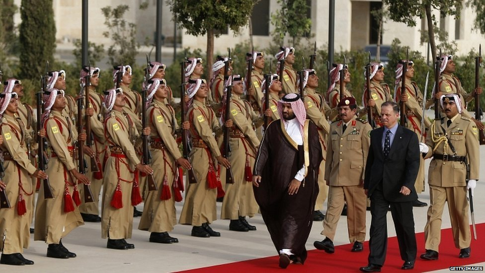 Jordan's Prince Faisal bin Al-Hussein (front R), and Saudi Arabia's Deputy Crown Prince Mohammed Bin Salman (front L) review Bedouin honour guards at the Royal Palace in Amman on 4 August 2015