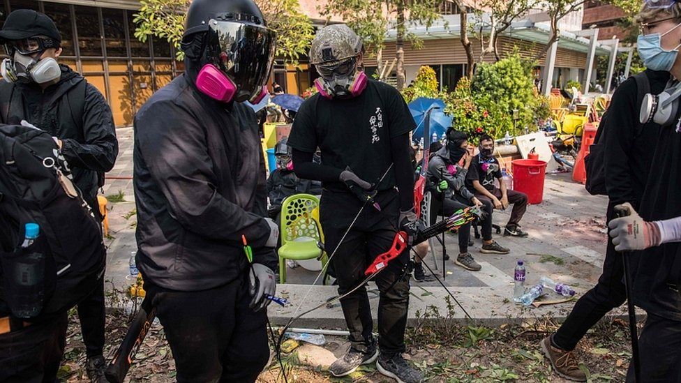 Protesters with bows and arrow at The Hong Kong Polytechnic University on November 14, 2019
