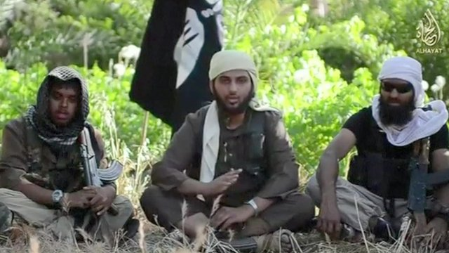 Still from video showing extremists