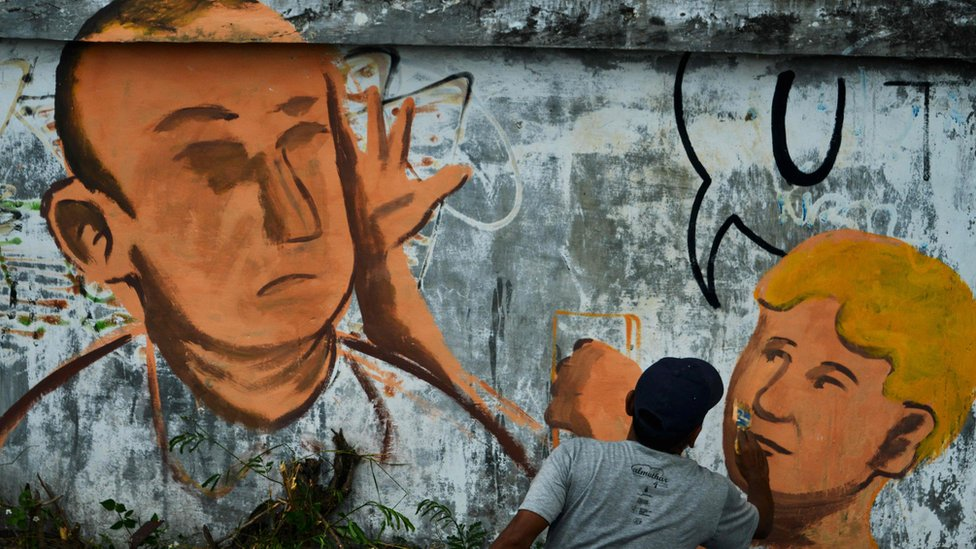 """Street art of the """"Egg Boy"""" incident in Indonesia"""