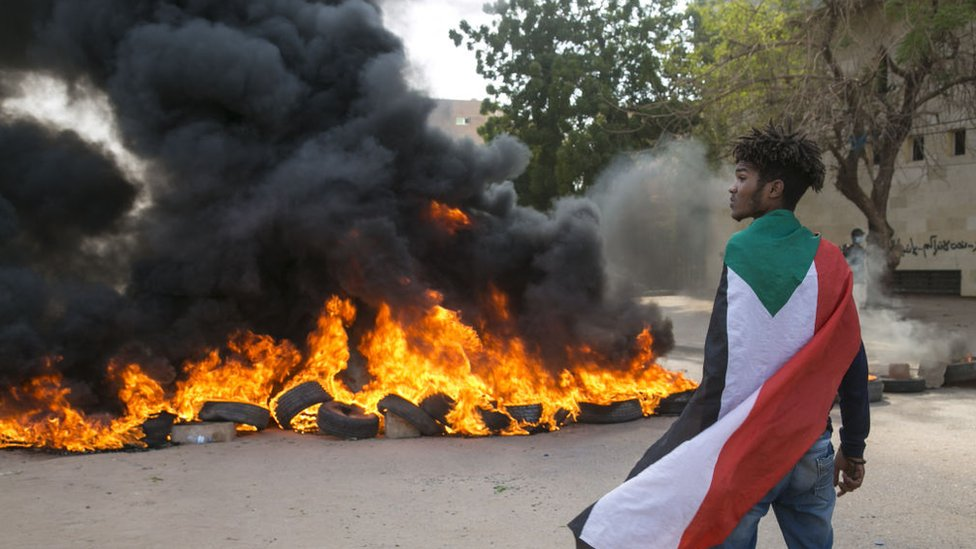 Protesters block roads and burn tyres during a protest against economic crisis and high cost of living in Khartoum, Sudan on October 21, 2020.