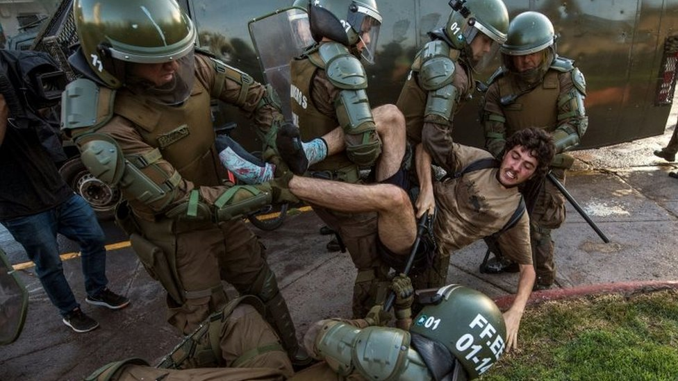 A demonstrator is arrested by riot police during a protest for the death of Mapuche Camilo Catrillanca in Santiago, on November 15, 2018.
