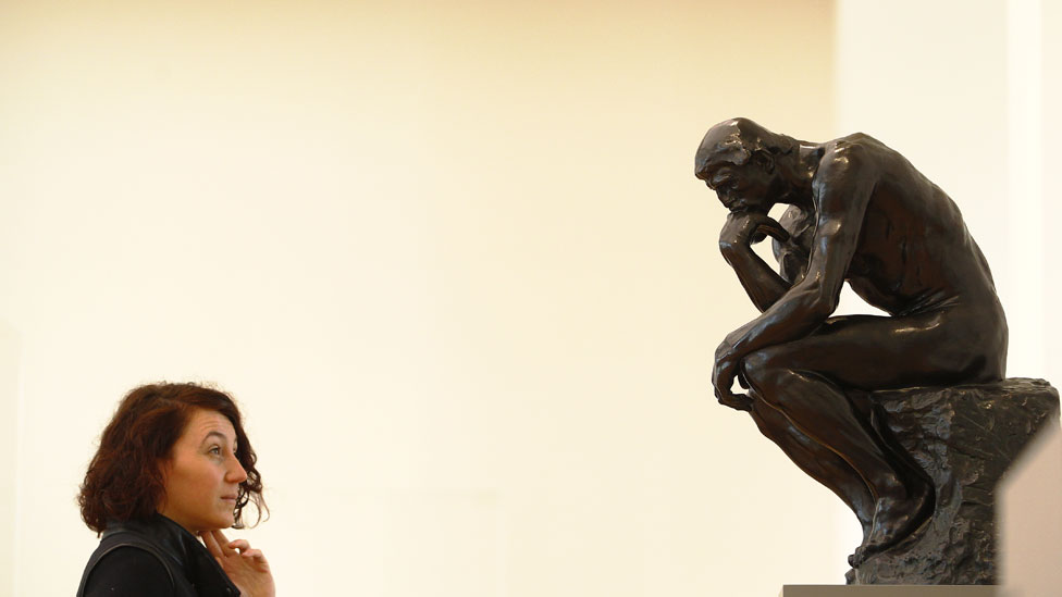 Visitor looks at of the Sculpture of Auguste Rodin, The Thinker, during a press preview in the Barberini Museum on January 19, 2017 in Potsdam, Germany
