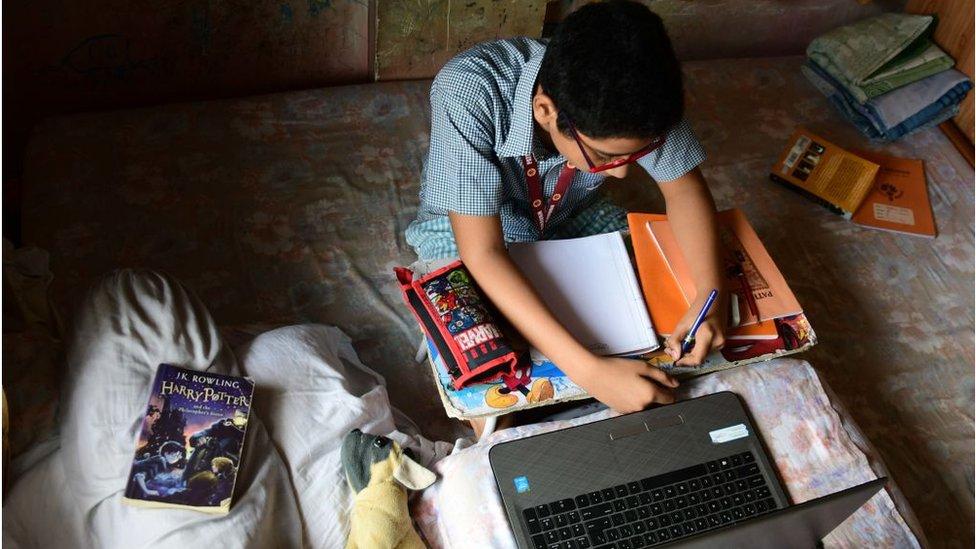 A school student attending an online class from home