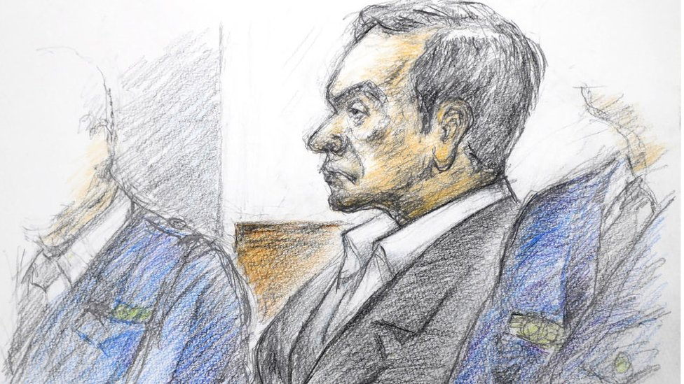 This courtroom sketch illustrated by Masato Yamashita depicts former Nissan chairman Carlos Ghosn attending his hearing at the Tokyo district court on January 8, 2019