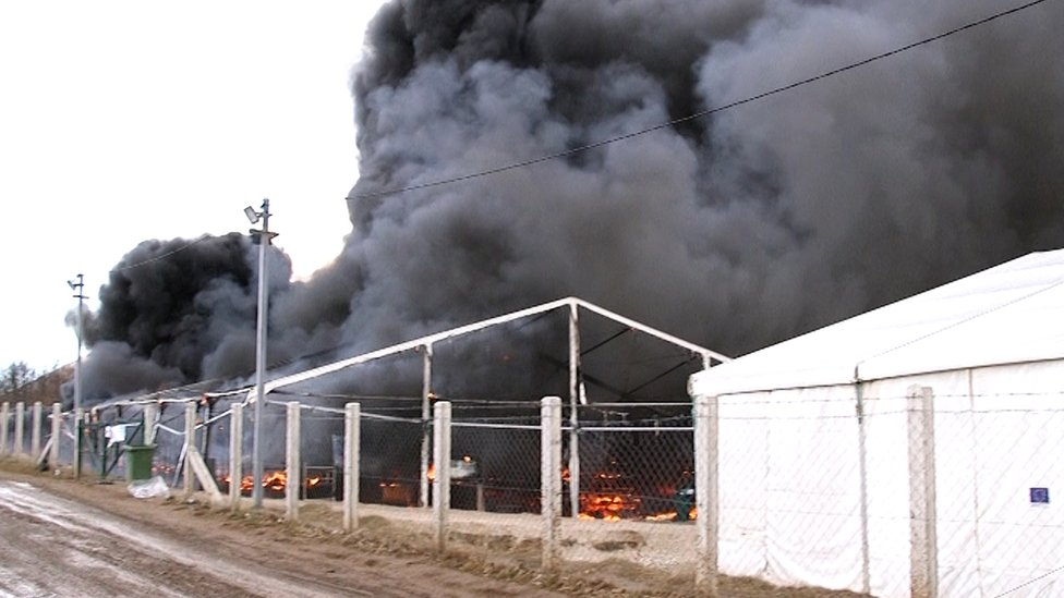 The Lipa migrant camp is seen under fire in Bihac, Bosnia and Herzegovina