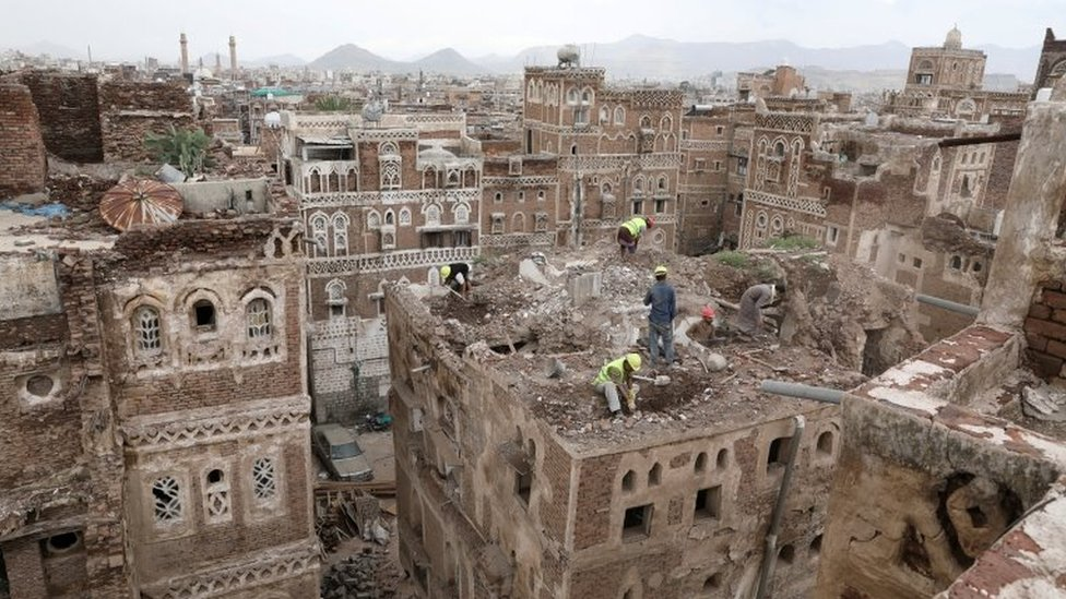 Workers demolish a rain-damaged building in the Old City of Sanaa, Yemen (9 August 2020)