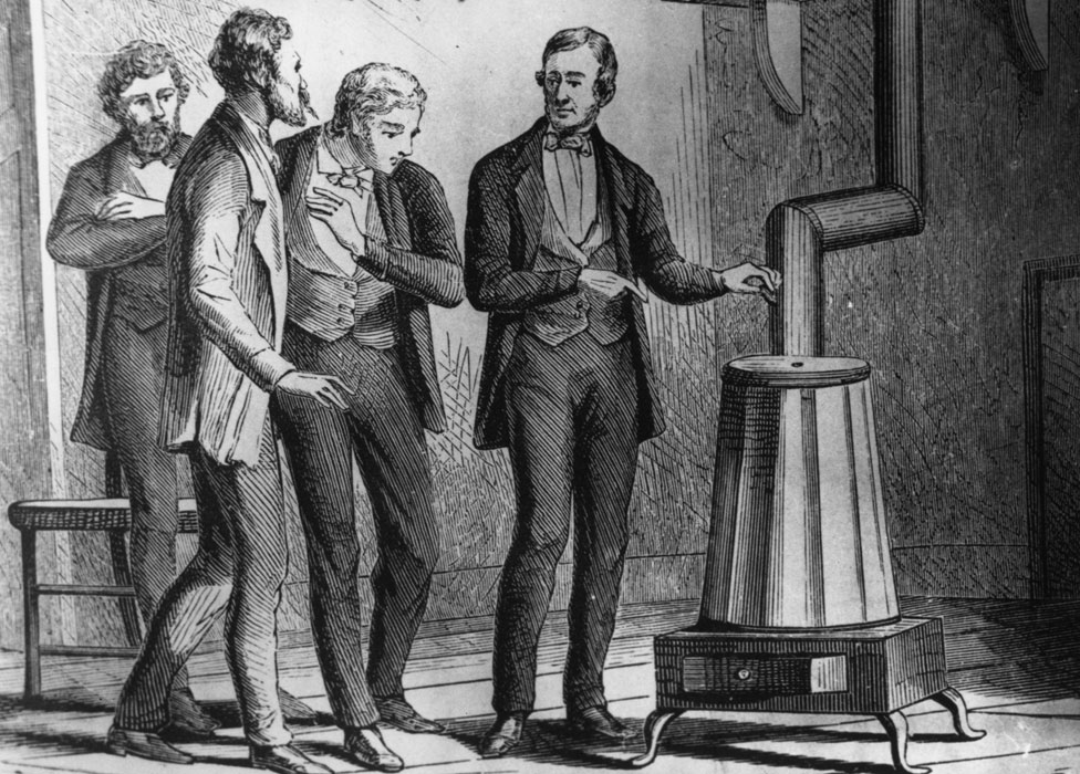 Charles Goodyear demonstrating his new dry heat rubber vulcanisation process, which prevented rubber becoming sticky