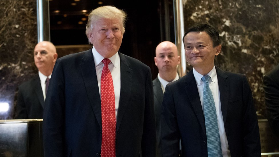 President-elect Donald Trump and Jack Ma, Chairman of Alibaba Group, emerge from the elevators to speak to reporters following their meeting at Trump Tower, January 9, 2017 in New York City.